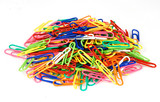 Isolated colorful pile of paper clips - good office background poster