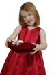 Young girl holding a heart valentine box of chocolates