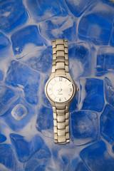 wrist watch on ice cubes.