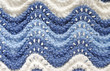 hand knitting background with lacy waves