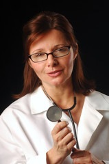 Doctor holding a stethoscope about to examine a patient