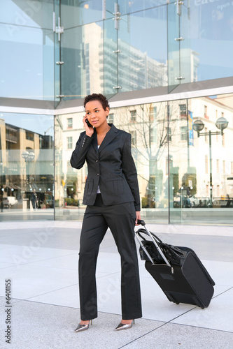 poster of A pretty african american business woman travelling