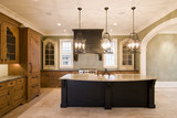 opulent kitchen in complementary colors with granite island poster