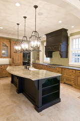 opulent kitchen with complimentary colored cabinets
