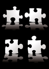 four piece puzzle black background with a shadow