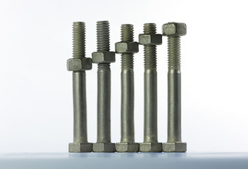 Five screw-bolts standing ia a row