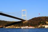 Istanbul Turkey. Ferry passing by Bosphorus bridge poster
