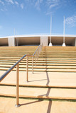 Steps going up to the Aspire Sports Centre in Doha, Qatar poster