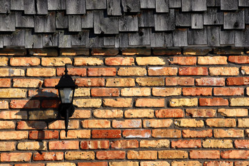 Shingles Over Brick Wall