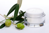 ar of moisturizing face cream and twig with green olives.. poster