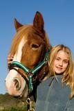 child stroking pet horse poster