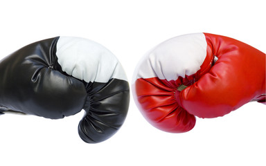 Red and black boxing gloves competition isolated over white