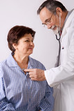 Patient is being observed by doctor poster