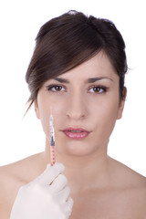 A young woman holding an syringe