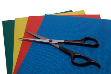 scissors on colored paper on white 3