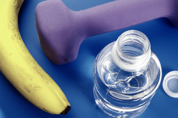 Bottle of water, banana, and small weight