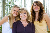 Beautiful grandmother with her lovely teen granddaughters. poster