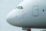 Nose of very big, wide-body airliner on the ground poster