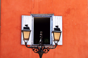 street lamp in front of open window