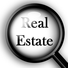 """Magnifier closeup on """"real estate"""""""