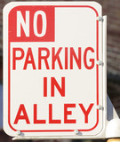 """No parking in Alley"" road sign"