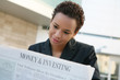 A african american business woman with newspaper