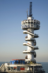 tower at the pier used for bungee-jumping