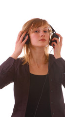 blond girl  teenager with headphones listens to musik