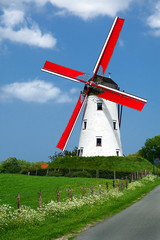 Traditional windmill with red vanes in the Holland countryside
