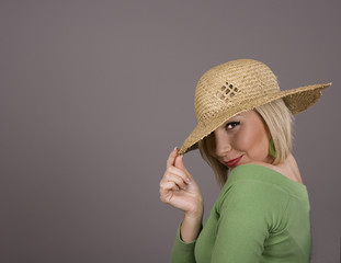 Blonde Straw Hat Over One Eye