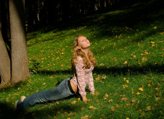 Girl doing exercises on the grass