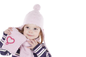 happy little girl in winter outfit, studio shot, isolated