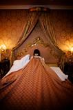 shamed girl in bed covering herself poster
