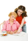 Teen girl helping her grandmother fill out paperwork  poster