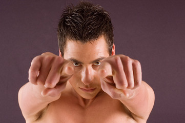 Young man pointing with fingers at you