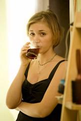 girl drinks red vine