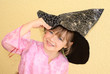 Five-year-old girl keeps witches hat in his hand.  Halloween.