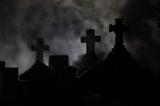 Headstone cross in Graveyard at night. poster