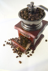 A nice small coffee grinder with coffee seeds