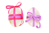 Two egg shaped semiprecious gemstones decorated for Easter poster