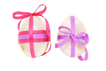 Two egg shaped semiprecious gemstones decorated for Easter