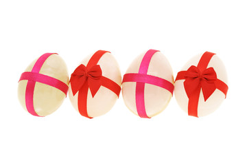 Egg shaped semiprecious gemstones decorated for Easter