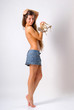 topless girl with long hair in skirt with hair and holding shoes