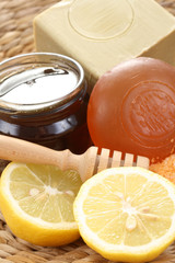 bar of gliceryne soap and jar of honey and lemon - natural bath