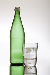 A glass of iced water and bottle