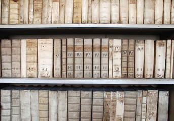 Library shelves with ancient medieval medical books