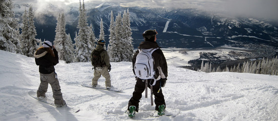 snowboarders on high mountain