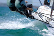 Sailors splash through the waves during a regatta. - 6465574