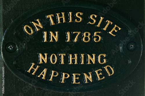 "Metal plaque with ""Nothing happened here"" message"
