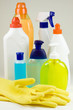 Colored plastic detergent bottles and yellow rubber gloves